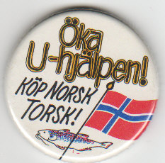 "A fish, Norway's flag, and a Swedish phrase, making fun of Norwegians, saying, ""Increase Third World aid; buy Norwegian cod!"""