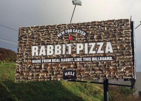 You read correctly - the billboard is covered in rabbit pelts.