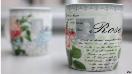 Roses, script, and a Hitler stamp, with your tea!